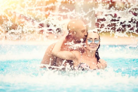 Happy couple in the pool