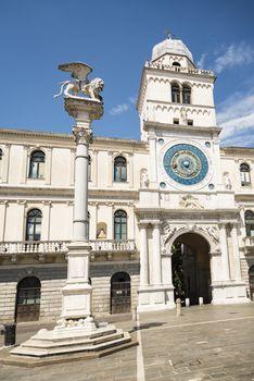 The facade of old Palazzo del Podesta in the city center in Padova, Italy