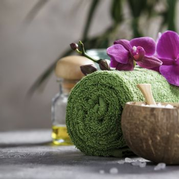 Spa Concept. Beautiful Spa Products on concrete background