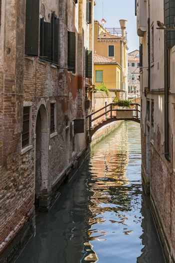 beautiful view of the canal with a floating boat in Venice, Italy