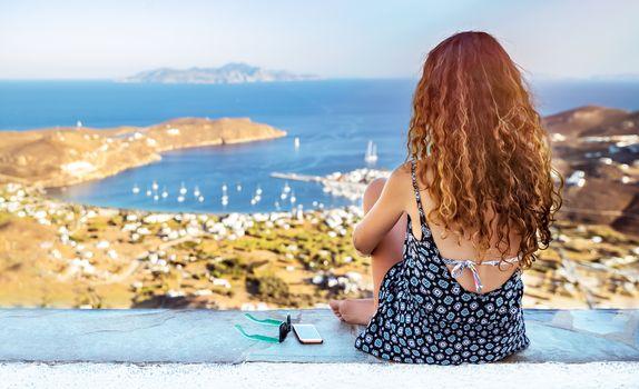 Traveler woman enjoying sea view