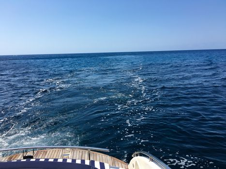view from the boat behind to the ocean