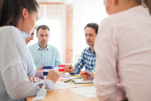 Group of business people busy discussing financial matter during meeting