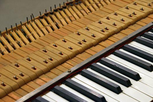 Close up old vintage piano keyboard tuning