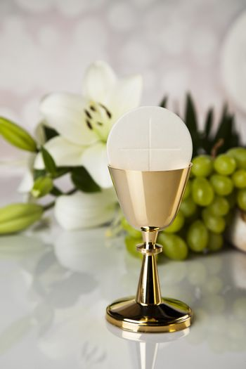 Eucharist symbol of bread and wine, chalice and host, First comm