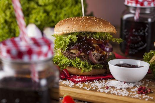 Fresh burger closeup on wooden desk background