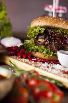 Home made hamburge, wooden desk background