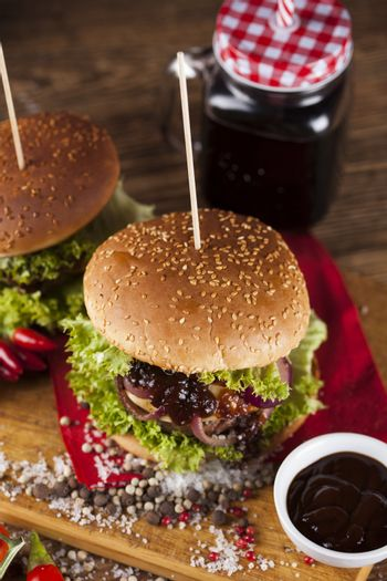 Close-up of home made burgers, wooden desk background