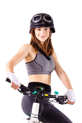 girl with a mountain bike and helmet