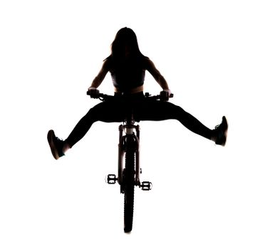 silhouette girl on a mountainbike