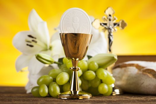 Symbol christianity religion a golden chalice with grapes and br