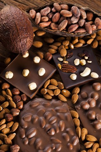 Bars Chocolate , candy sweet, dessert food on wooden background