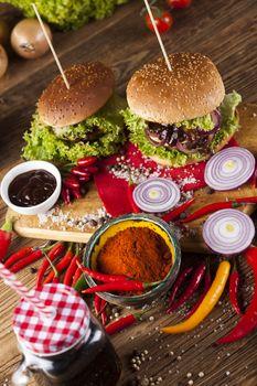 Closeup of homemade hamburger with fresh vegetables