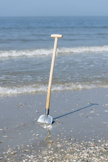 Shovel in the sand from the North Sea Beach