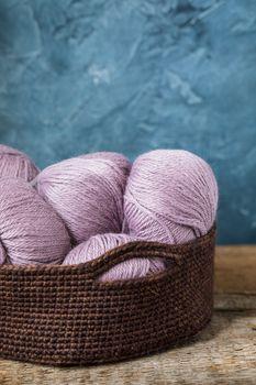 Pink wool yarn in the crocheted basket