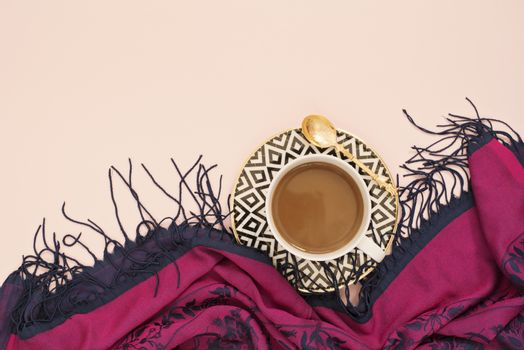 Coffee, latte in a white, black and gold coffee cup. Feminine workplace concept. Freelance fashion comfortable femininity workspace with coffee. Bright pink and purple background