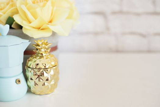 Brick Wall Product Display. Yellow Roses Mock Up. Styled Stock Photography. Blue coffee maker, golden pineapple on white desk. Fashion femininity workspace, Styled Stock Photo