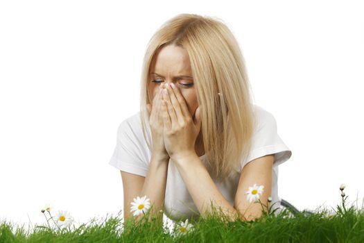 Woman sneezing of spring allergy