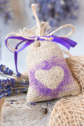 Sachet with Lavender on the rustic background