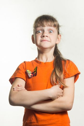 A lapel portrait of a gay little girl with funny eyes bulging