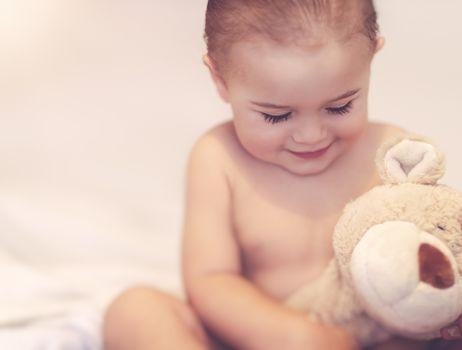 Cute baby with a bear