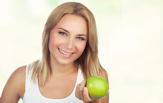 Pretty woman with apple