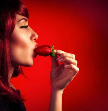 Seductive woman with strawberry
