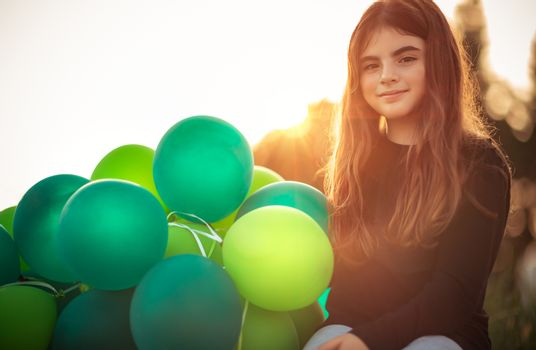 Pretty girl with air balloons