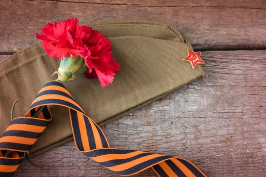 The George ribbon on the field cap, 9 may Victory Day postcard concept
