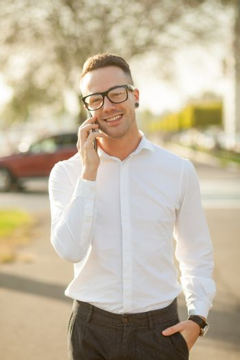Man with glasses speak on mobile phone in hands