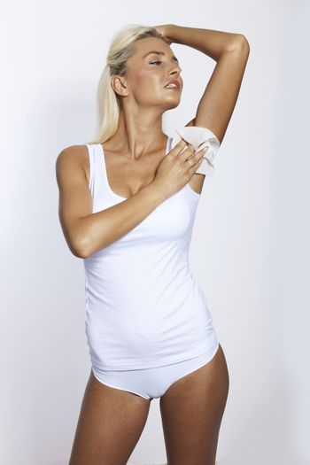 Woman wipes the armpit with wet wipes