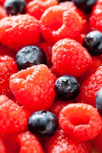 Bunch Of Raspberries And Blueberries