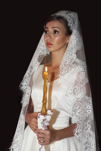 The beautiful bride on wedding ceremony in the Russian Church. Moscow