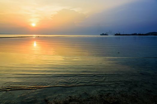 Beautiful nature landscape of Nathon Pier and boat on the sea. And colorful of the sunset sky at Nathon Beach Viewpoint, Ko Samui island, Surat Thani, Thailand