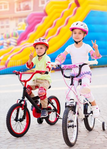 Happy friends on the bicycles