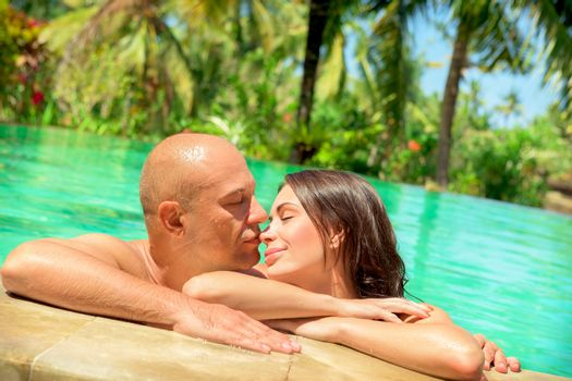 Loving couple in a pool