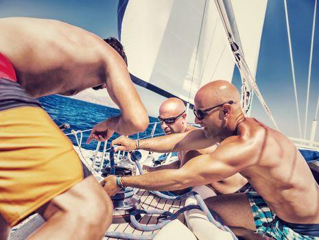 Sailors working on sailboat