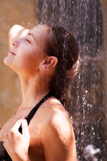 Woman relaxed in the shower