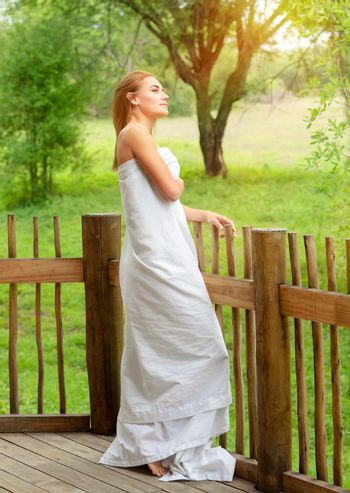 Gentle woman standing on the porch