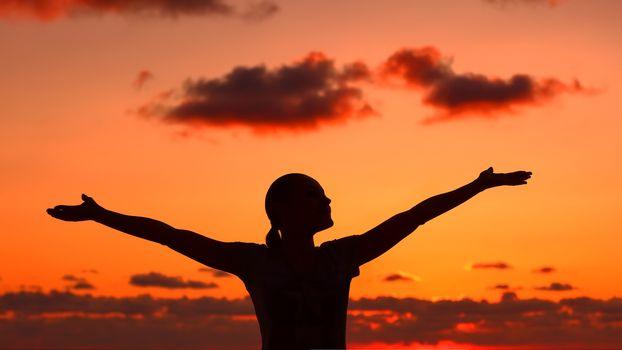 Woman's silhouette on sunset light