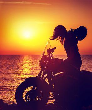 Silhouette of a biker woman