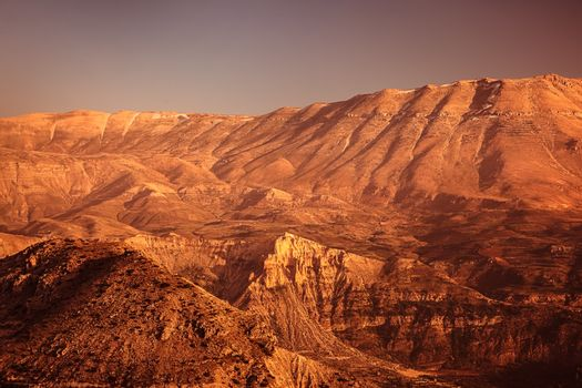 Beautiful desertic landscape, dry orange sandstone mountains, amazing view on the wilderness