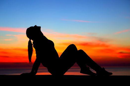 Woman enjoying sunset