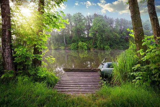 Fishing lake in sunny evening