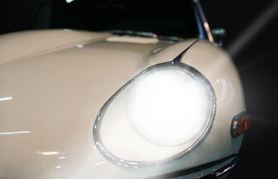 white car headlight close-up