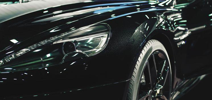 black car headlight close-up