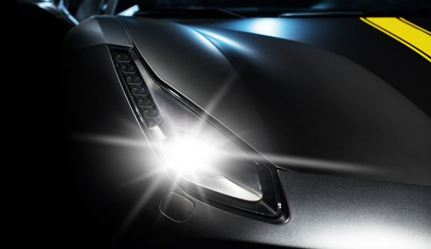 sports car headlight close-up