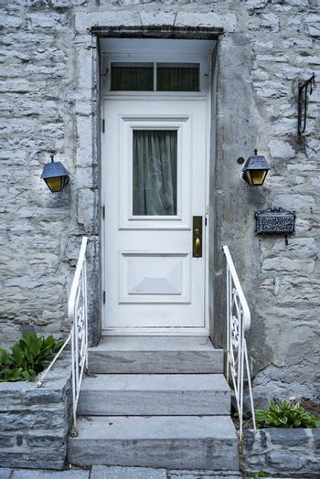 Wooden door entrance in the historical district in Quebec City, Canada
