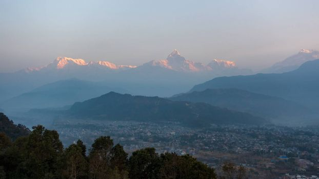 View of of the Machapuchare and the Annapurnas at sunrise from Sarangkot in Nepal