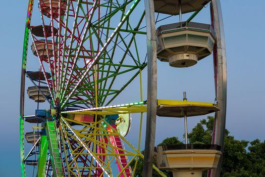 Ferris Wheel in Fun Fair during PortlandRose Festival at evening twilight hour